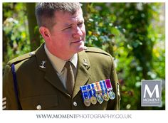 Candid photo of an army veteran at Adam & Helen's wedding at Gants Mill, Bruton, Somerset. www.gantsmill.co.uk
