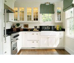 I like the clean feel of this kitchen, although I wouldn't want so much white in mine.