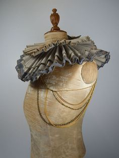 Vicky Saragouda Neckpiece: Maud, 2012 Materials: upcycled cloth, vintage lace, leather thread, upcycled chains, found objects 41 x 13 x 21 cm