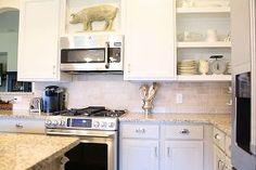chalk painted kitchen cabinets, chalk paint, doors, home decor, kitchen cabinets, kitchen design, The stove and microwave with new upper cabinets we built