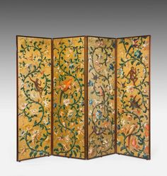 OnlineGalleries.com - A fine 19th Century gold ground Four fold Screen, the main panels with monkeys seated in exotic foliage and eating fruits, the reverse side of William Morris linen fabric.
