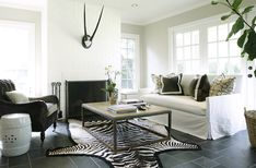 Suzie: Ashley Goforth Design - Modern, chic living room design with white slip-covered sofa, . Chic Living Room, Home Living Room, Living Room Designs, Living Spaces, Transitional Living Rooms, Fireplace Design, Brick Fireplace, Room Decor, Room Art