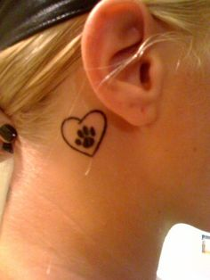 Paw print heart tattoo