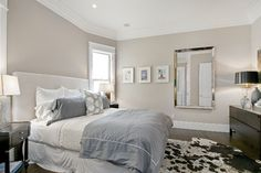 Master Bedroom, Taupe Walls, Crown Molding, Molding Around Windows, Smaller Windows on Either Side of Bed, Grays and Teals