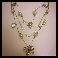 Betsey Johnson Bow and Pearl Necklace Betsey Johnson Bow and Pearl Neclace.  3 gold strands.  One is all rhinestones and the other two are combinations of bows pearls and some hearts.  Has multiple sizing settings Betsey Johnson Jewelry Necklaces