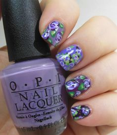 Get in on the garden trend with this purple bouquet nail art.