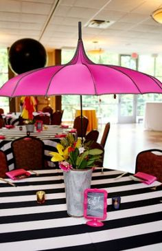 A pink parasol was used on top of the Bat Mitzvah centerpieces at this Paris theme!
