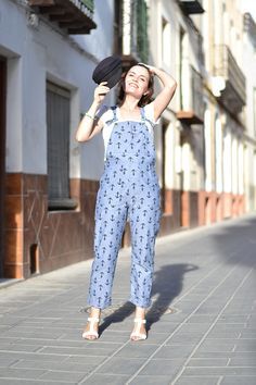Turia dungarees feature patch pockets, adjustable straps, ankle length or short versions.