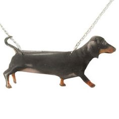 - Details - Sizing - Shipping An adorable dog inspired necklace that features a handmade pendant in the shape of a super realistic Dachshund puppy in tan and black! For more handmade jewelry and produ