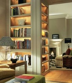 Appears to be gold leaf shelving with lighting