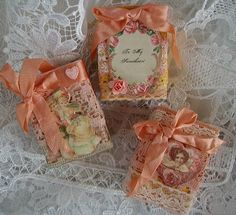 Tiny altered matchboxes. How cute to put small jewelry gifts in!
