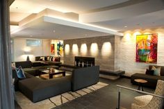 Common area with a variety of ceiling details.  Painted brick blended with sleek contemporary stone fireplace surround.