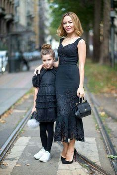 """Mommy and I in all black dresses. I should have black shoes, don't you think?"""