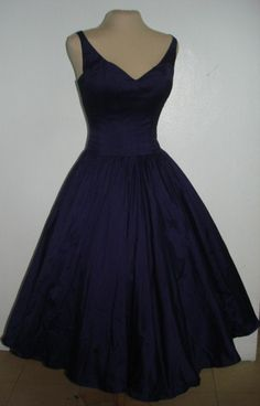 A sexy yet elegant 50s style cocktail dress in Navy