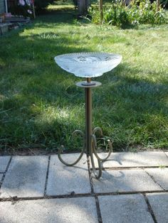 repurposed birdbath or feeder. Made with lamp base and old light fixture cover.
