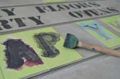 painting letters onto fabric with annie sloan chalk paint.