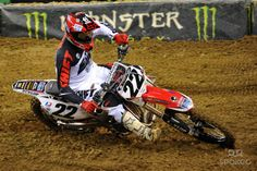 Chad Reed (22) goes through a corner during the Seattle supercross at Quest Field.