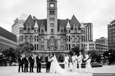 Artistic, black and white wedding photography; wedding party in black tuxes and white bridesmaid dresses