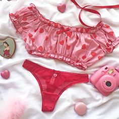 This adorable peasant crop top is made from a soft and light poly chiffon. If features the sweetest lollipop heart print on a pink background. It is gathered at the neckline, under bust and arms, with a sweet red elastic trim. It is comfy yet cute and makes the perfect little pajama