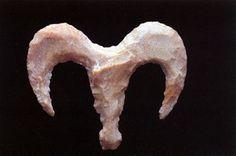 Found in Nekhen (Hierakonpolis) of a horned animal in frontal view.