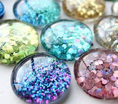 What You Will Need ~ Clear flat back 'marbles' The glass dome you can find at the craft store or dollar store. Make sure they are clear.~ E6000 Glue ~ GLITTER!!! Martha Stewart Octagon Glitter and semi fine dollar store glitter ~A paint brush ~Varnish (used Folkart)