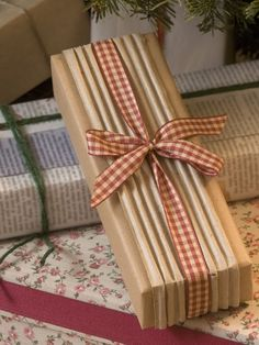 Mix Textures Put small pieces of interesting paper to work. Ridged cardboard adds textural interest when paired with brown Kraft paper. Pretty gingham ribbon adds color.