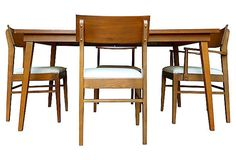 Fantastic mid century modern walnut dining set. Four dining chairs (one arm chair, three side chairs), stunning from all angles - newly reupholstered in