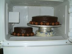 Two tiers trying to survive the heat in the fridge.