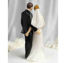 Crown your wedding day with this fun cake topper.