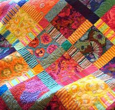 Etsy seller says: This beautiful Kaffe Fassett fabric jumps off this quilt with its bold colors and designs. Ive mixed his fabric with bold stripes and set them on Patchwork Quilting, Scrappy Quilts, Baby Quilts, Diy Quilting, Quilting Board, Quilting Ideas, Textiles, Quilting Designs, Quilting Projects