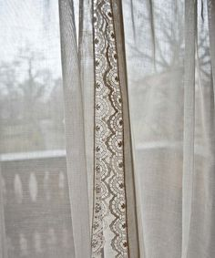 Gossamer. Light flows through in cream washes. Finest net curtains with creamy lace crochet edges. Romantic and evocative. From a professional roller skater and rodeo riders estate. 80 inches long x 33 inches wide excellent vintage condition pressed and freshly laundered