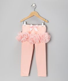 Tiers of curly, swirly tulle create a ballerina-worthy skirt atop these soft, stretchy leggings, creating the perfect hybrid for little ones to prance, frolic and boogie the day away. Skirt: 100% polyesterLeggings: 95% polyester / 5% spandexMachine wash; tumble dryImported