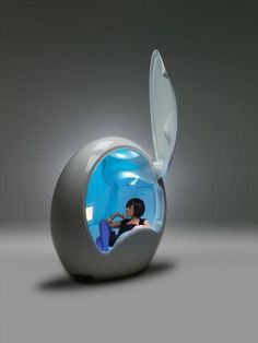 YES!!! The Mommy time out place. Little TV screen, cup holders, reclines back. Sound proof...I will take one please! (I realize this is actually a Gaming Pod. It's for guys... but I would make one as a hiding place....for me)