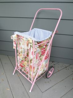 vintage grocery cart, painted pink and lined with reversible fabric. This would be so much fun to use at the flea market!