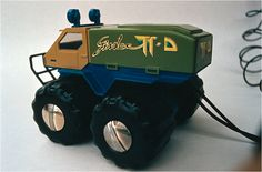"Gândac (Bug) TT-D - off-road - amphibious truck - wire remote controlled toy. In water, the tyres profiles act as palettes and help the toy move forward. Created by romanian designer Catalin Urcan for ""Viitorul"" Enterprise (now, Plastor) - city Oradea, Romania in 1985-1988"
