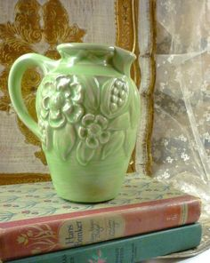 vintage green jug with books
