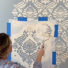 DIY painted and stenciled faux damask wallpaper ideas on a budget using easy to use damask wall stencil patters from Cutting Edge Stencils