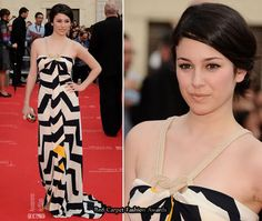 Actress Blanca Suarez opted for a more casual look wearing a navy and white zig-zag print Diane von Furstenberg scarf dress, with of yellow print running through the dress.