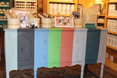 Buffet painted to look like the cover of the Annie Sloan Chalk Paint® color card! This piece is the center of our Raleigh, NC location of Two Old Birds.