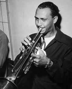 American jazz musician Ernie Royal (1921-1983) playing trumpet.