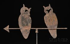 Sheet Iron Two Owls Silhouette Weathervane, America, early to mid-20th century, cutout sheet iron figures perched on an iron arrow, weathered layers of paint with some rusty surface, with stand, overall ht. 23 3/4, lg. 32 in.