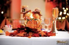 Scarecrow sweetheart table thanksgiving wedding decor | Real Green Wedding With A Thanksgiving Theme | Green Bride Guide