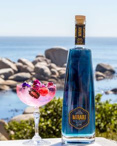 Mirari Blue Gin Fresh lime juice Berry syrup Mixed berries to garnish Blue Gin, Mixed Berries, Fresh Lime Juice, Distillery, Syrup, Vodka Bottle, Berry, Spices, Artisan