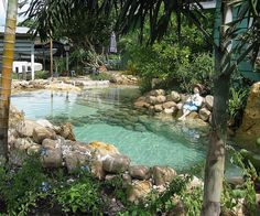 natural lagoon with white sand bottom by lucas congdon, via If you've ever thought about installing a pool, consider going all natural. It's less expensive, easier to maintain, and has a cooler overall look and feel than a traditional pool. You're friends and family will love it and the environment will be grateful that you're giving back to the earth.