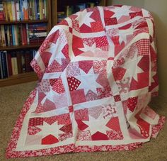 Red Quilt Using this Moda Bakeshop Tutorial  http://www.modabakeshop.com/2010/10/charming-stars-quilt.html