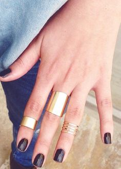 dark  nails and thick geometric rings