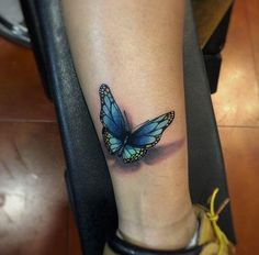This blue butterfly tattoo design looks more like a work of art, rather than an inking. It is a rather large piece that has been tattooed onto the lower leg. An array of different blues is used, along with clever shading which results in a beautiful outcome.