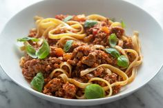 This hearty bolognese comes together in under an hour, but by the taste (and the aroma!) you'd swear it spent half the day simmering away on the stovetop. Giada Recipes, Pasta Recipes, Dinner Recipes, Cooking Recipes, Entree Recipes, Crockpot Recipes, Dinner Ideas, Chicken Recipes, Instant Pot Pressure Cooker