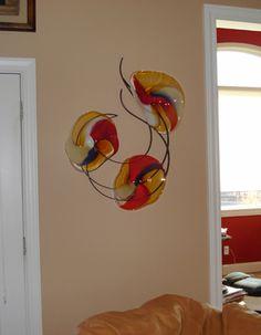 """Cascade Red.""  Blown glass and metal wall sculpture."