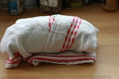 Store your fancy bread wrapped up in a kitchen towel. I've tried this for the last couple weeks and it works well. Bread stays super fresh for few days and is very toast worthy for a few days after that. no more throwing out a brick of useless bread.